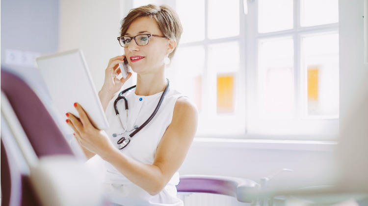 Doctor looking at information while on the phone