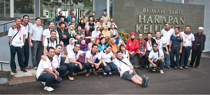 JFF_Staff and patients with eye bandages outside the Harapan Keluarga hospital